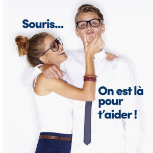 Portrait of a young man wearing glasses with his face being squashed by a pretty young woman